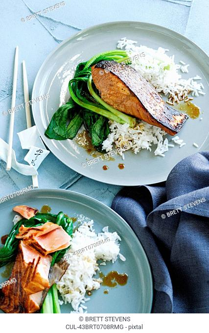 Plates of fish, rice and greens