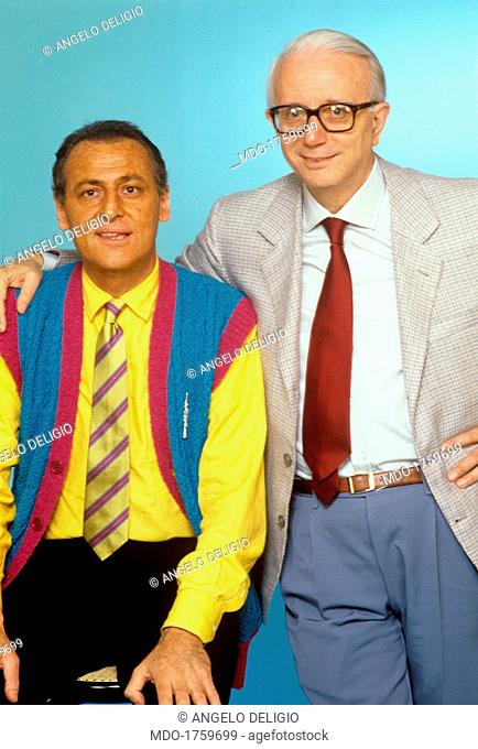 The journalist and writer Enzo Biagi hugs cordially the show man Renzo Arbore: they host cutting-edge broadcasts in the RAI nighttime show schedule