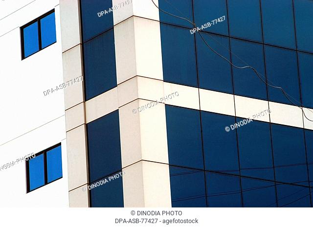 NR Chambers ; a modern commercial complex with blue glass windows in Bangalore city ; Karnataka ; India