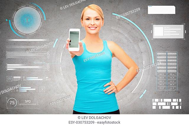 fitness, sport and technology concept - smiling woman with smartphone over gray concrete background