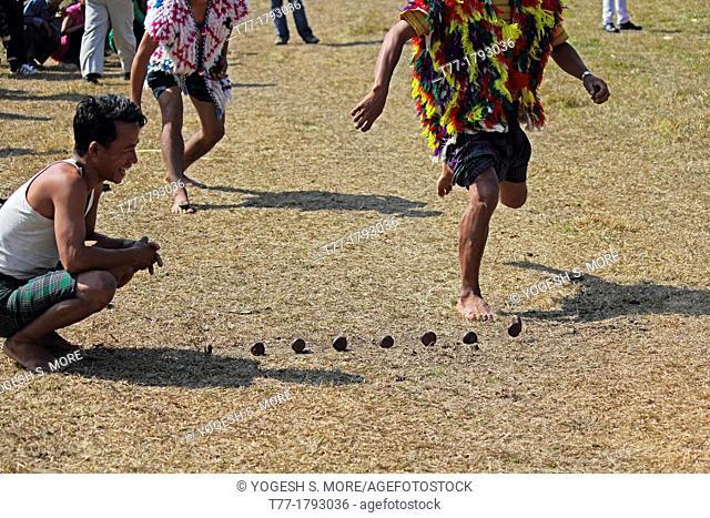 tribal playing stone kancha game at Namdapha Eco Cultural Festival, Miao, Arunachal Pradesh, India
