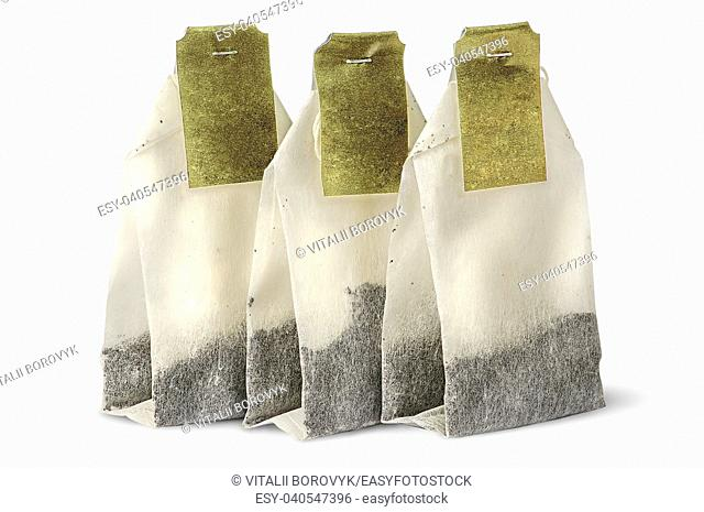 Three tea bags with labels isolated on white background