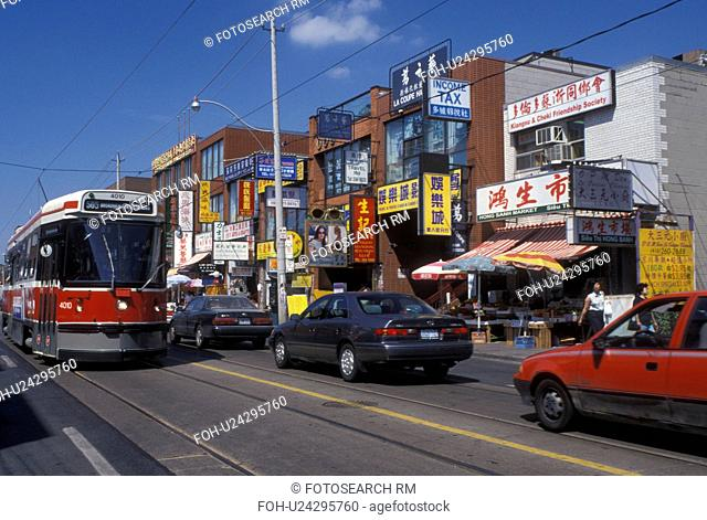 Toronto, Canada, Ontario, Trolley runs along the Dundas Street and Chinatown in downtown Toronto