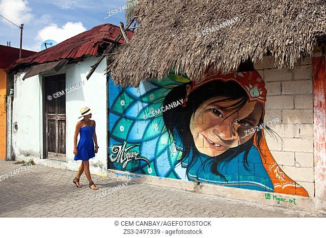 Tourist woman wearing a Panama Hat walking at the streets of Tulum town, Quintana Roo, Yucatan Province, Mexico, Central America