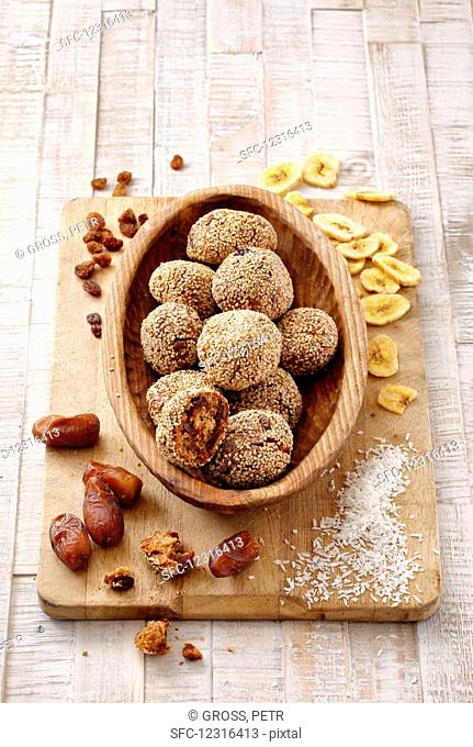 Fruit bread balls with sesame seeds and coconut