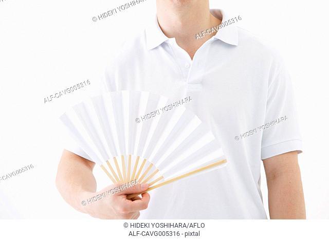 Businessman with paper fan