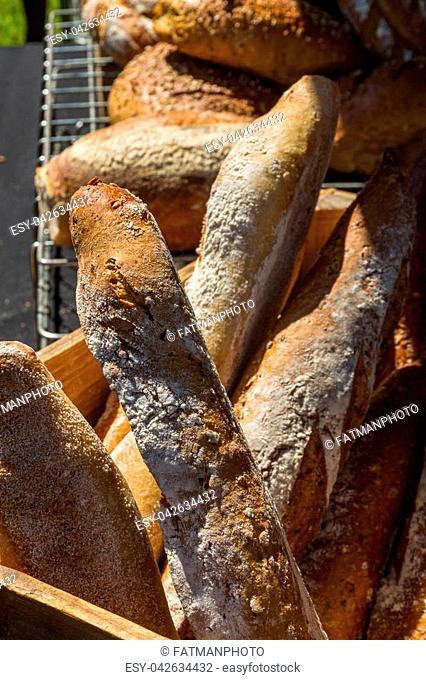 Freshly baked loaf bread sticks stacked