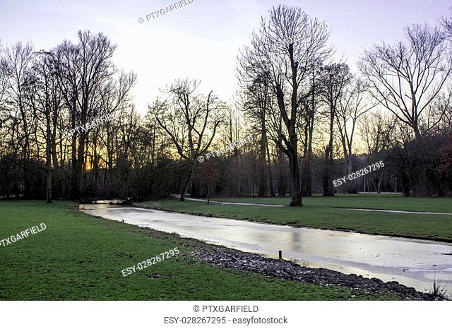 """Sunset in Vondelpark, Amsterdam. Is a public urban park of 47 hectares (120 acres), opened in 1865 and originally named the """"""""Nieuwe Park"""""""" and is a favorite..."""