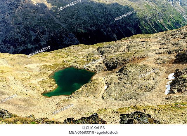 Over looking a rock pool among the piz rosatsch Mountain, Switzerland