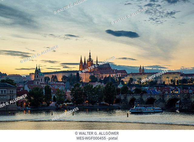 Czech Republic, Prague, Hradcany Castle and St Vitus Cathedral with Vltava River and Charles Bridge at sunset
