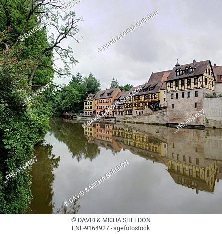 Half-timbered houses beside the Rednitz river in Stein, Franconia, Bavaria, Germany