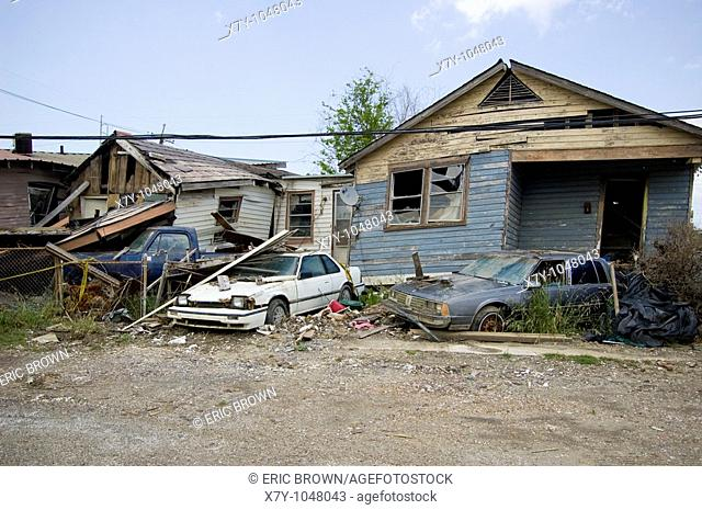 Cars and homes lie in rubble 9 months after Hurricane Katrina, in the Lower Ninth Ward, New Orleans