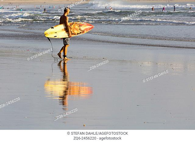 Surfer on Kuta Beach, Bali, Indonesia