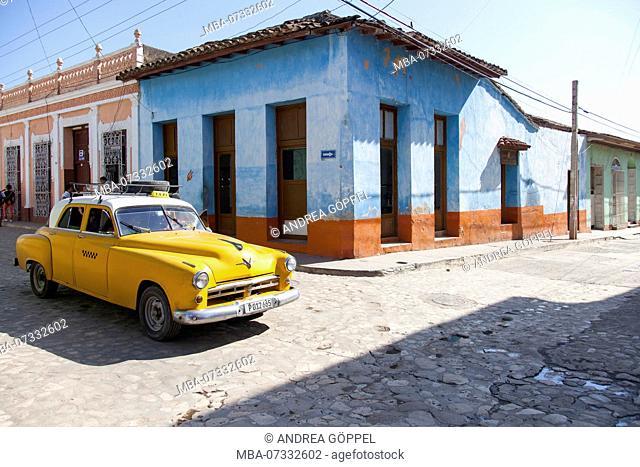 Caribbean, Cuba, Trinidad, yellow classic car at intersection
