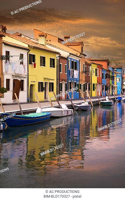 Gondolas parked in Venice Burano canal, Veneto, Italy