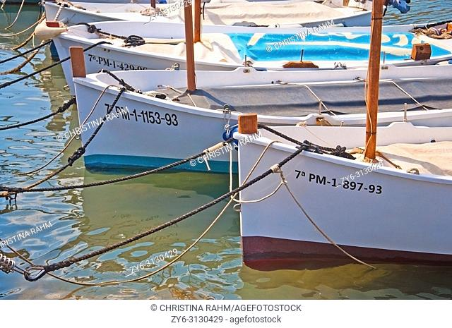 MALLORCA, SPAIN - JULY 21, 2012: Moored small llaut boats in Can Pastilla on a sunny summer day on on July 21, 2012 in Mallorca, Spain