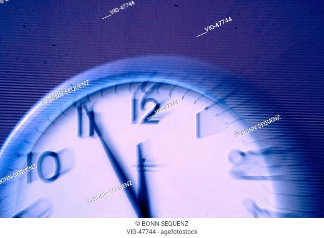 Symbolic picture: Clock shows five to twelve. (blurred) - BONN, GERMANY, 07/07/2003