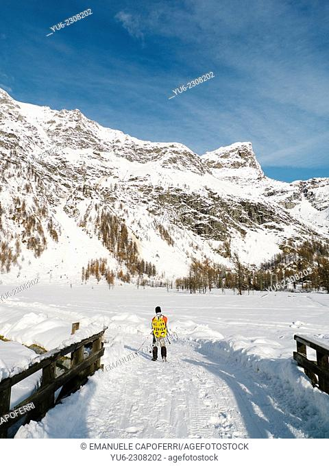 Hiker in the snow, Alpe Devero, Piedmont, Italy