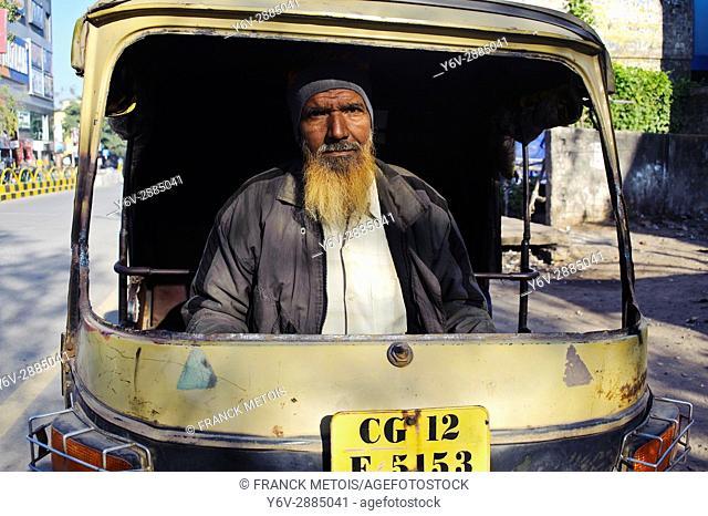 Muslim man driving an auto rickshaw without front screen ( Bilaspur, Chhattisgarh state, India)