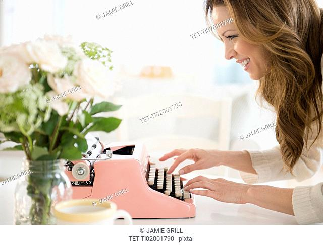 Profile of woman typewriting