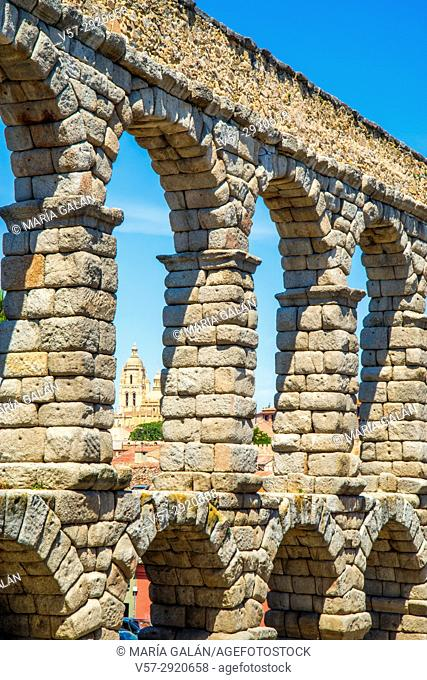 Cathedral viewed through the arches of the Roman aqueduct. Segovia, Spain