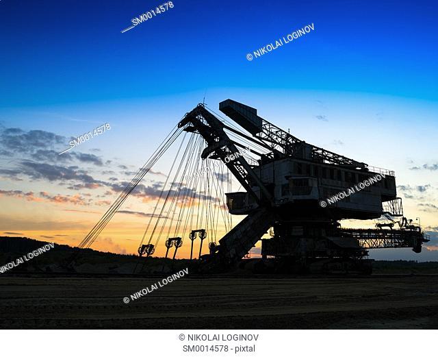 Horizontal vivid sunset industrial mining machine background backdrop