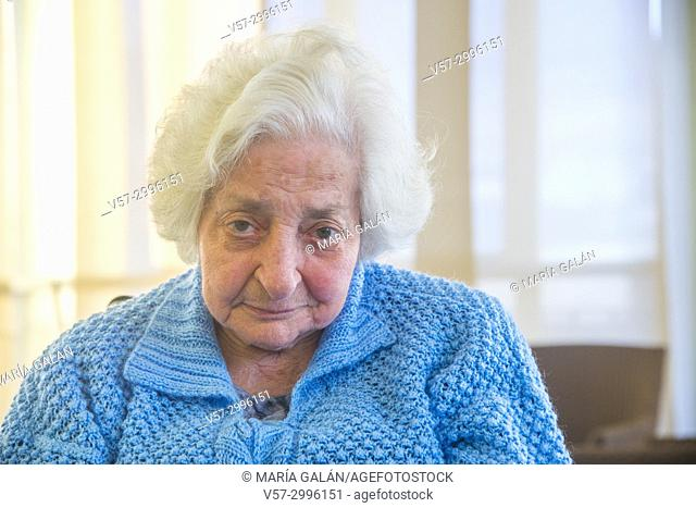 Portrait of old lady looking at the camera