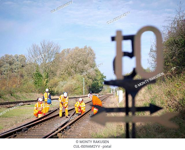 Railway workers on railway track