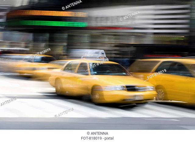 Yellow taxi's on a city street, Manhattan, New York City
