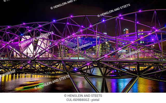 Cityscape with purple helix bridge over Marina Bay at night, Singapore, South East Asia