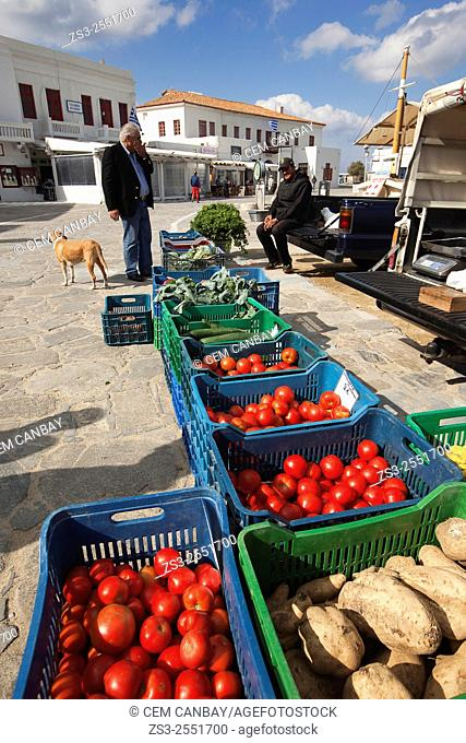 Vendor selling vegetables at the open-air market near the sea, Mykonos, Cyclades Islands, Greek Islands, Greece, Europe