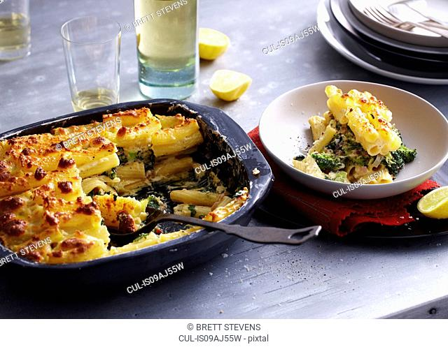 Baking tin and bowl serving of pasticcio