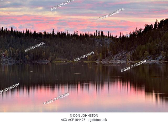 Evening skies reflected in Madelaine Lake, Madelaine Lake Territorial Park, Yellowknife, Northwest Territories, Canada