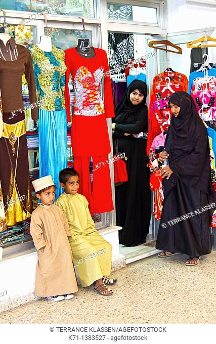 A clothing store and women in traditional muslim dress in Fujairah, UAE