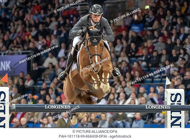 18 November 2018, Baden-Wuerttemberg, Stuttgart: 34th International Horse Show German Masters, Equestrian Sport, Jumping