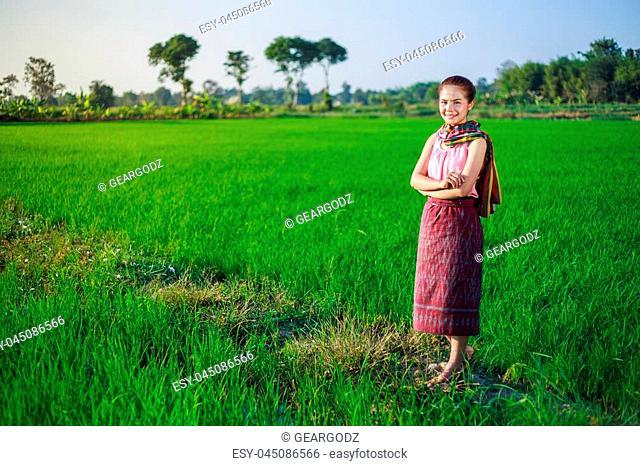 beautiful farmer woman in rice field, Thailand
