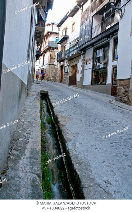 Street and canal for water, called regadera. Candelario, Salamanca province, Castilla Leon, Spain