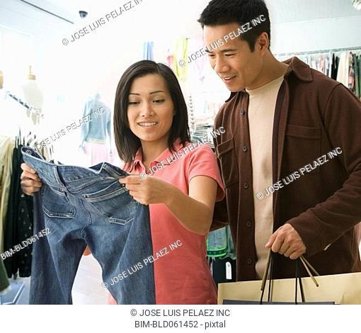 Asian couple clothing shopping