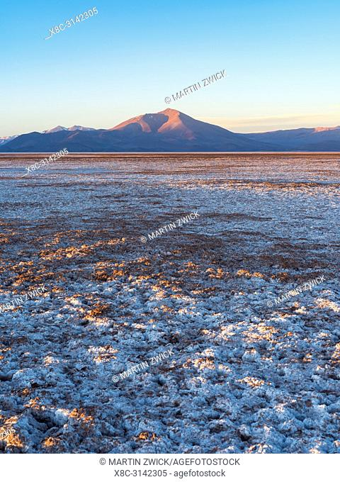 Sunset over Salar de Arizaro, one of the largest salt flats in the world. The Altiplano near village Tolar Grande in Argentina close to the border to Chile