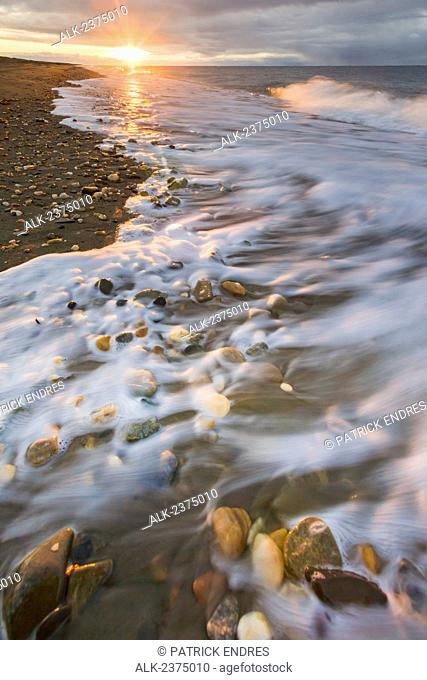 Coastal landscape of waves washing upon the sandy beach along Norton Sound, Bering Sea, Nome, Arctic Alaska