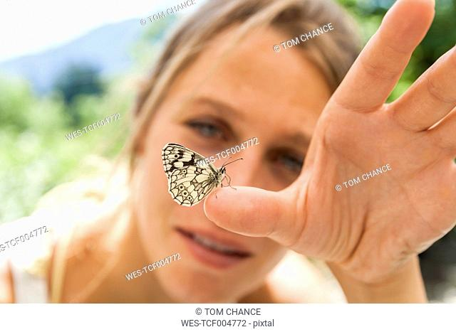 Butterfly on woman's hand