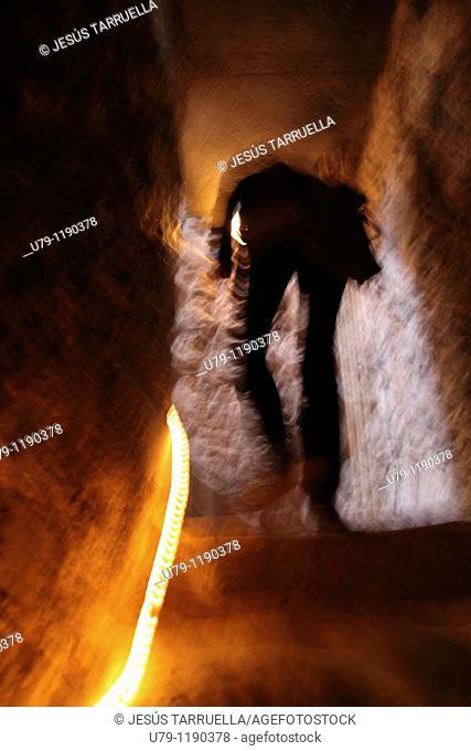 Silhouette of Woman climbing the stairs of the Church of Santa Maria  Villena  Alicante  Valencia  Spain  Europe