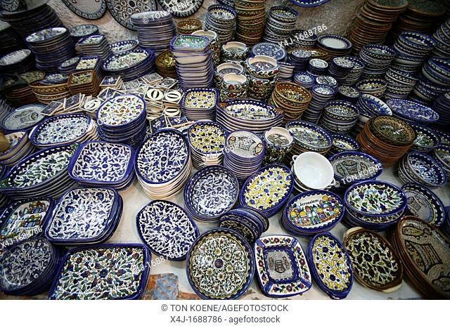 Painted pottery souvenirs for sale at a market in the old city of Jerusalem