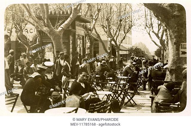 Street cafe, Blida, Algeria, North Africa -- Royal Navy sailors and others on Easter Monday, 6 April 1931