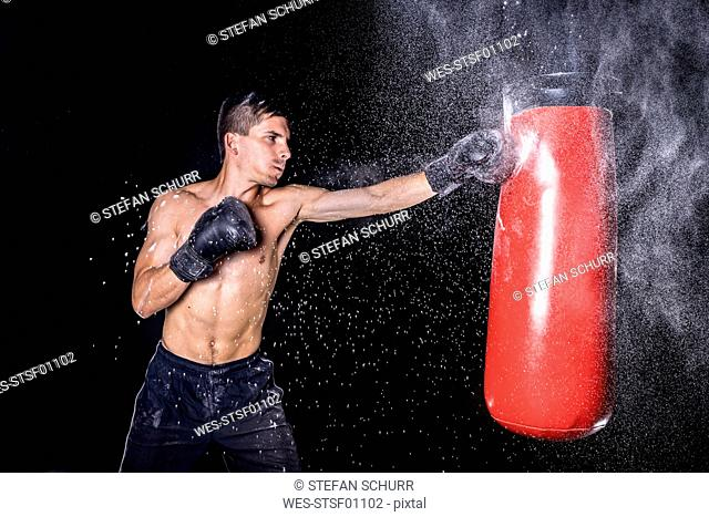 Boxer hitting punch bag