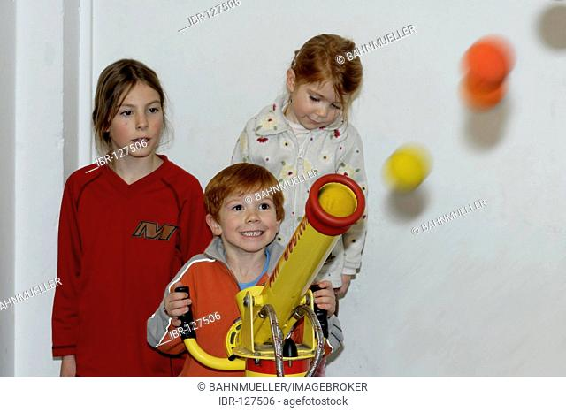 Children are having fun while playing together air shoots softball shooting