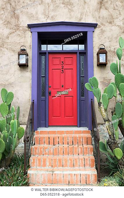 Red door and prickly pear cactus in Presidio historic district. Tucson. Arizona, USA