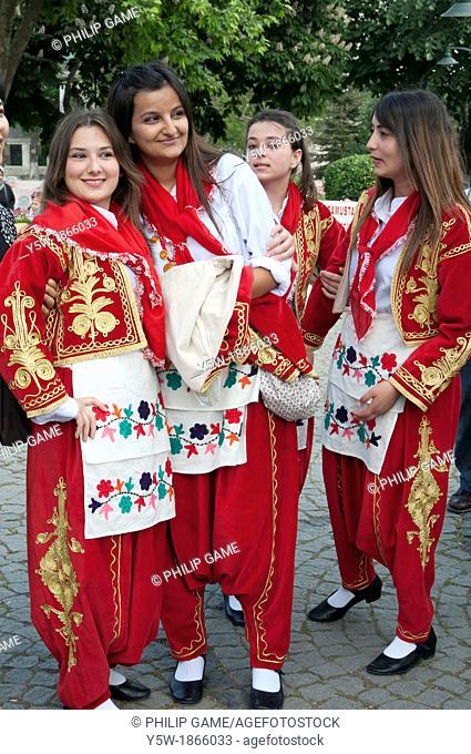 Schoolchildren dressed in folk costume await their turn to perform at a concert in Sultanahmet Park, Istanbul