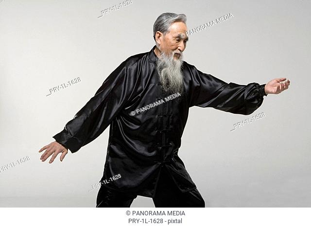an old man doing Taiji