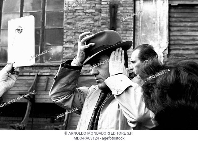 Italian actor Alberto Sordi taking a break on the set of The Police Commissioner. Italy, 1962